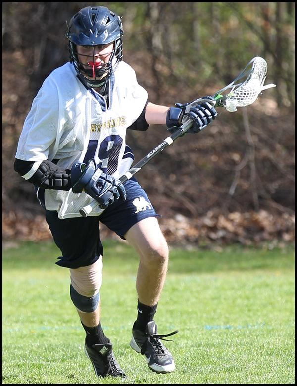 Student Playing Lacrosse